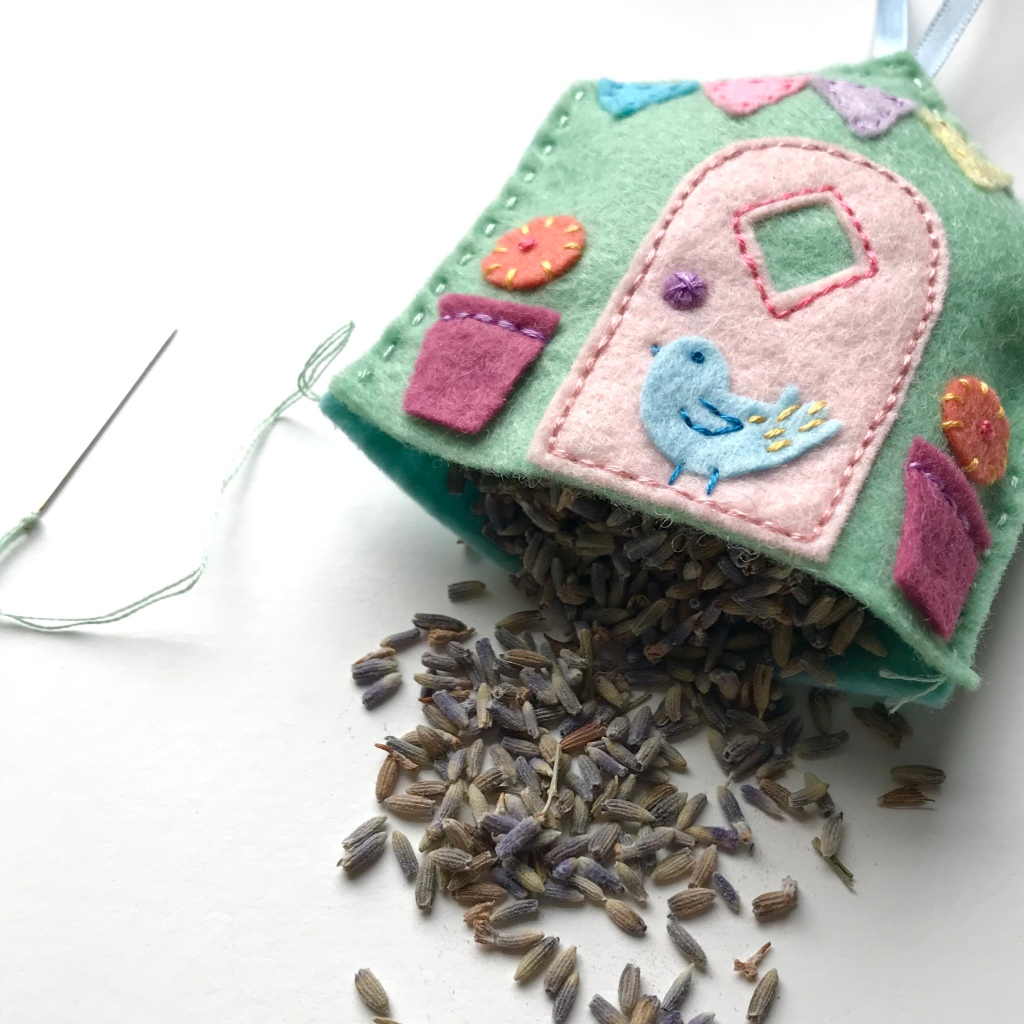 Lavender flowers being stuffed into a lavender bag
